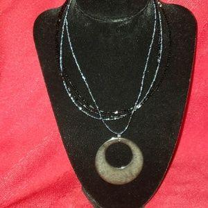 Round pendant beaded black necklace